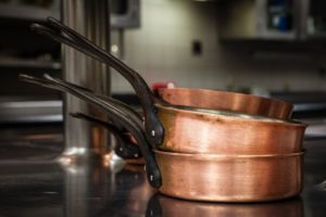 Copper pans stacked on Stove