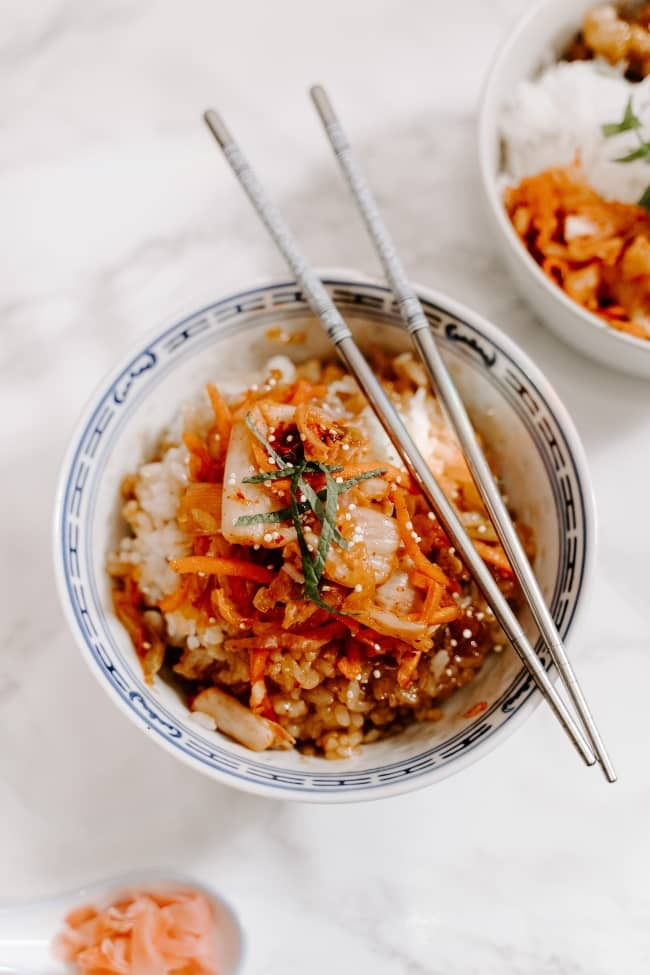 Kimchi Bowl with rice and chopsticks