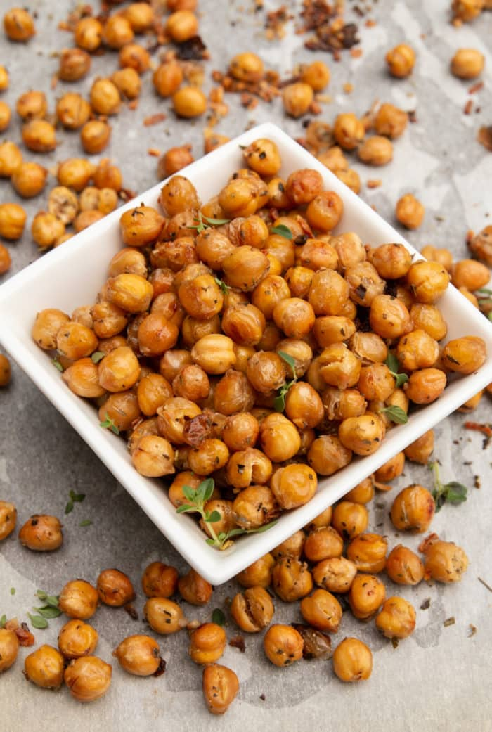 garlic roasted chickpeas in a white serving bowl