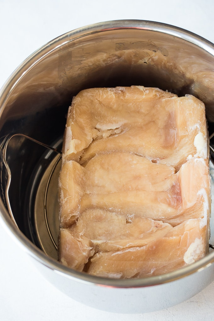 frozen chicken breasts on the bottom of an Instant Pot