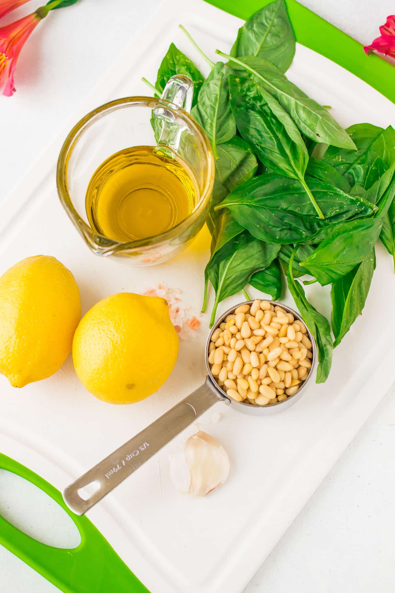 pesto sauce ingredients on a cutting board