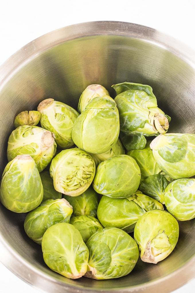Fresh brussels sprouts ready to be prepped for air frying.