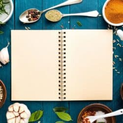 blank journal with spices around it