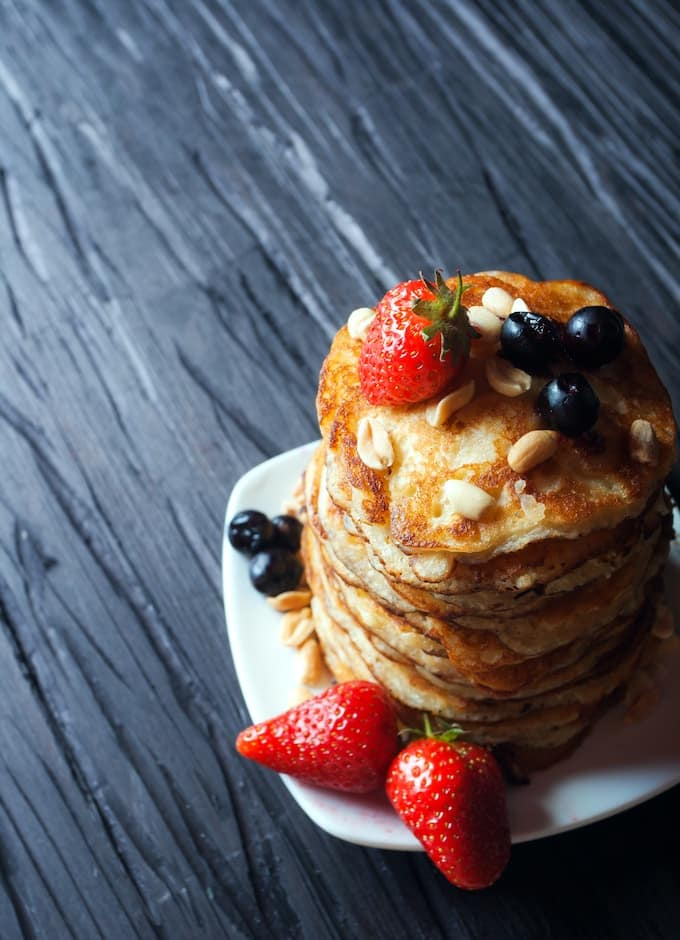 plate of pancakes with strawberries on top