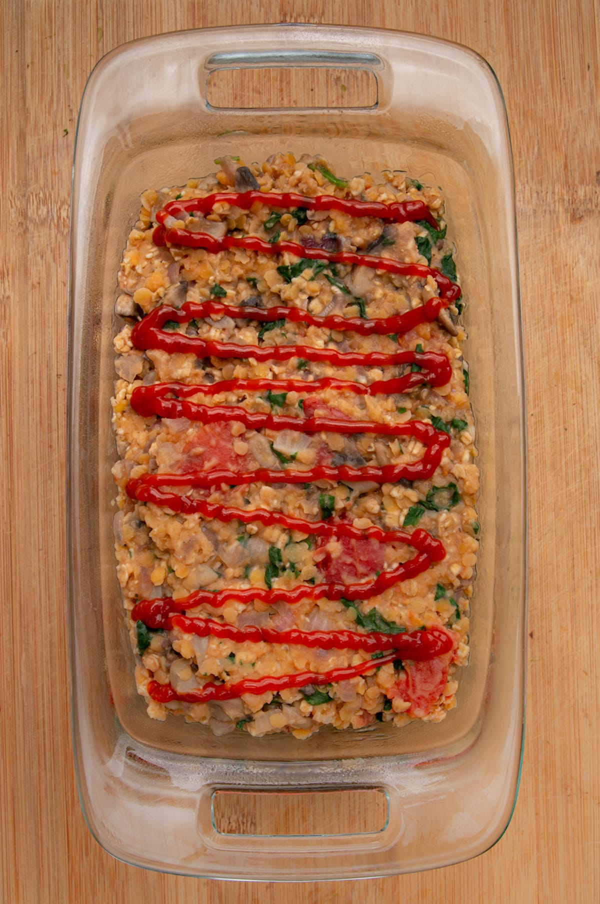 lentil loaf in baking dish ready to be baked