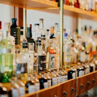Alcohol bottles on a bar shelf