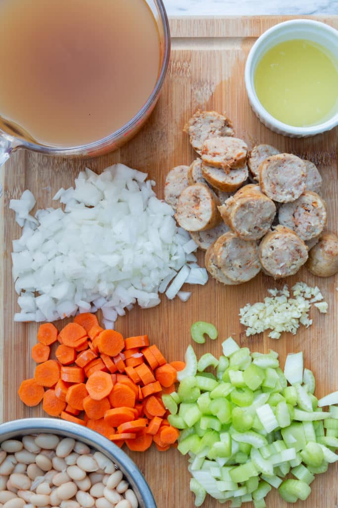 Prep and chop onions, carrots, celery, and garlic to add to beans and chicken stock for a delicious and hearty Instant Pot Stew.