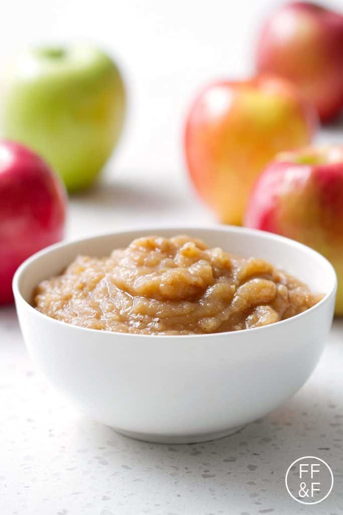 Slow cooker apple sauce in a white bowl