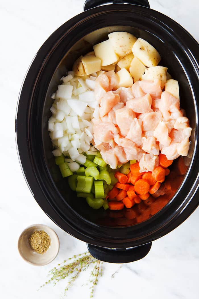 This slow cooker chicken breast stew contains potatoes, onions, carrots and celery and cooks in the crock pot in just a few hours.