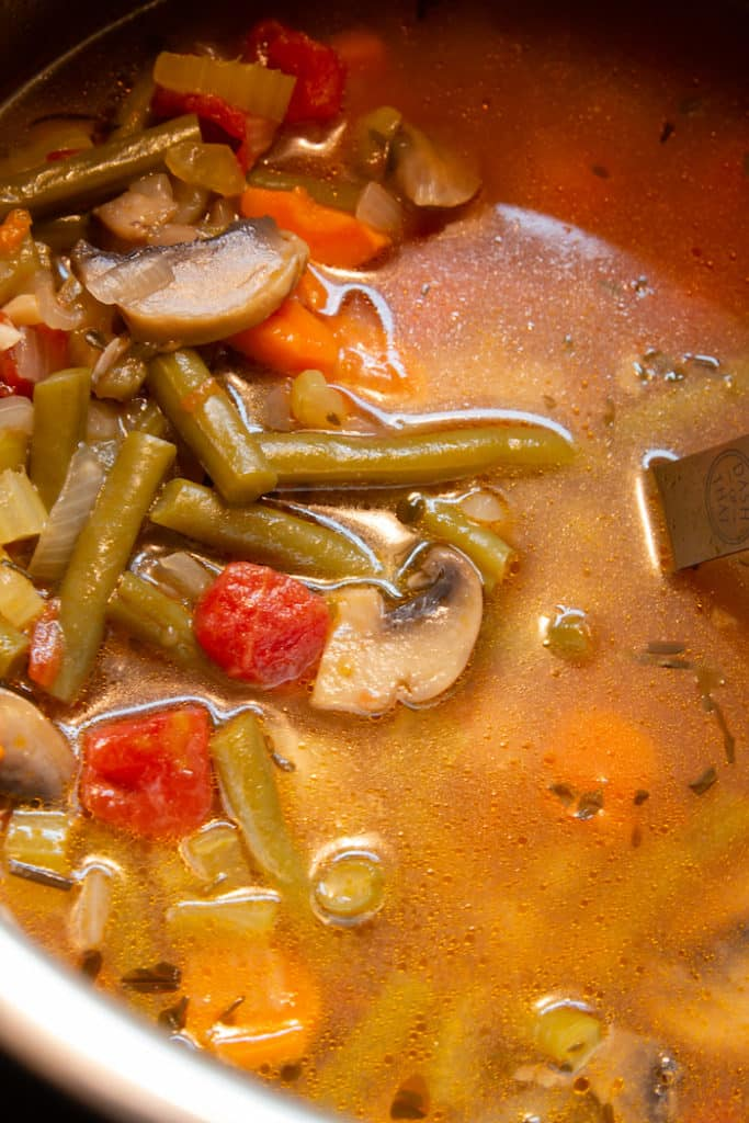 Hearty pressure cooker vegetable soup is loaded with veggies.