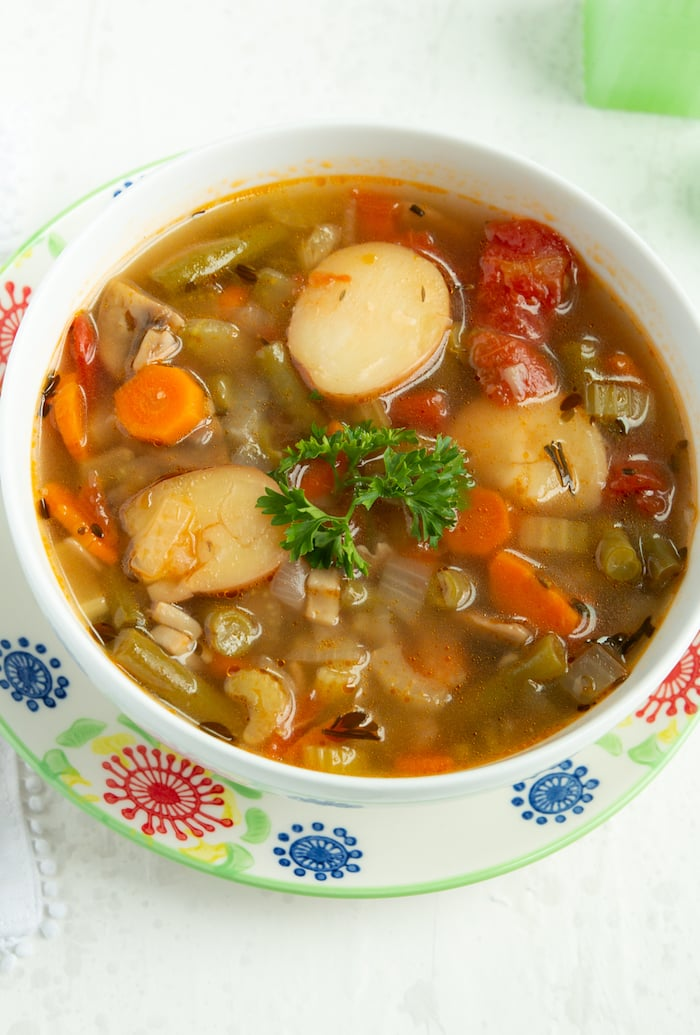 A bowl of hearty and nourishing vegetable soup made in the Instant Pot in about 30 minutes.
