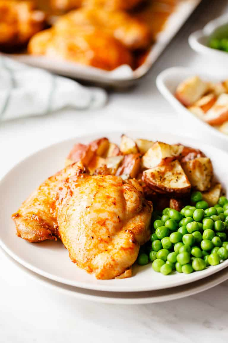 This tasty chicken thigh dinner is baked with paprika and loaded with flavor. Serve with peas and roasted potatoes for an easy weeknight dinner.