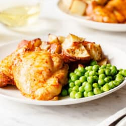 dinner plate with chicken, peas and potatoes