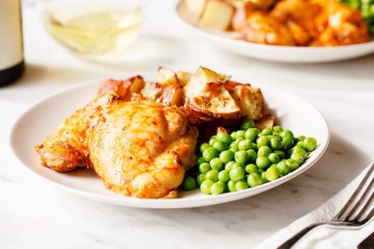 paprika-baked-boneless-chicken-thighs with peas