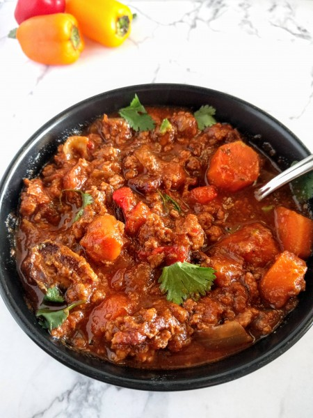 whole30 crockpot chili in a black bowl