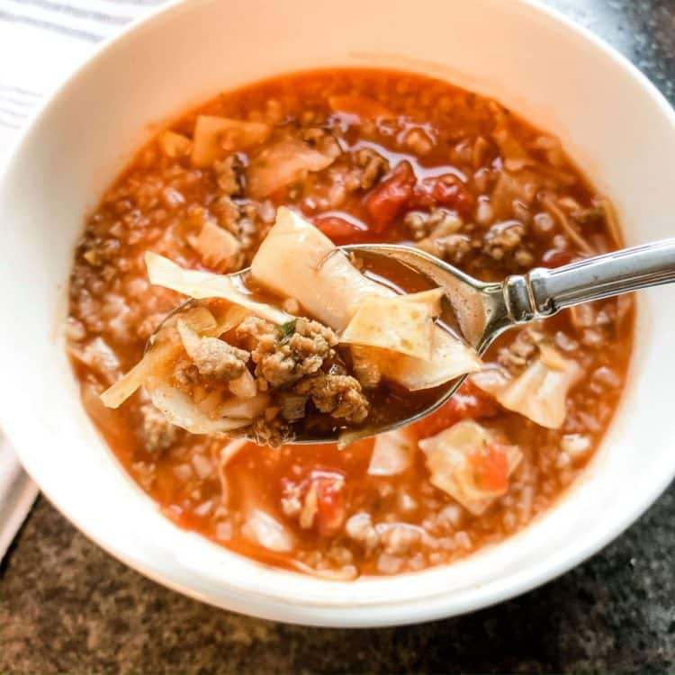 Slow cooker cabbage soup in a white bowl