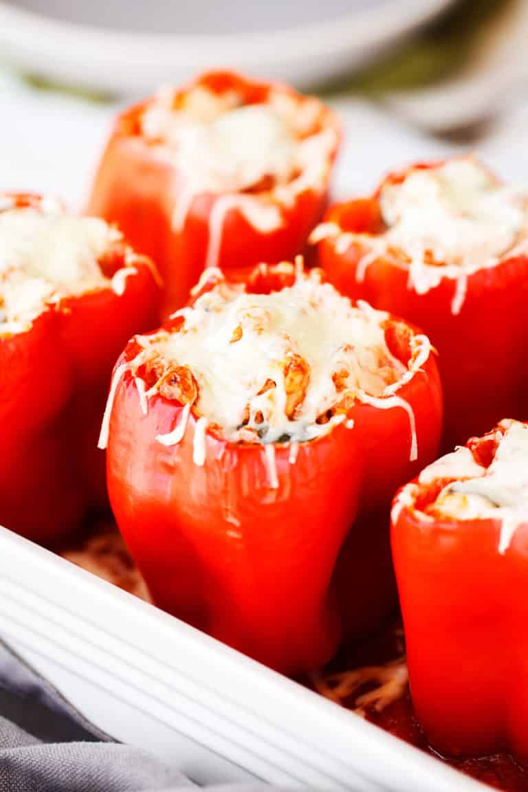 stuffed peppers with melted vegan cheese on top