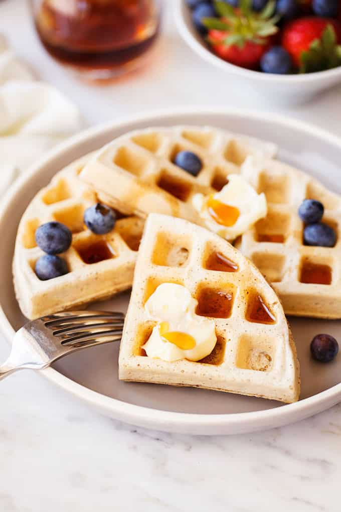 Delicious and healthy vegan waffles topped with blueberries.