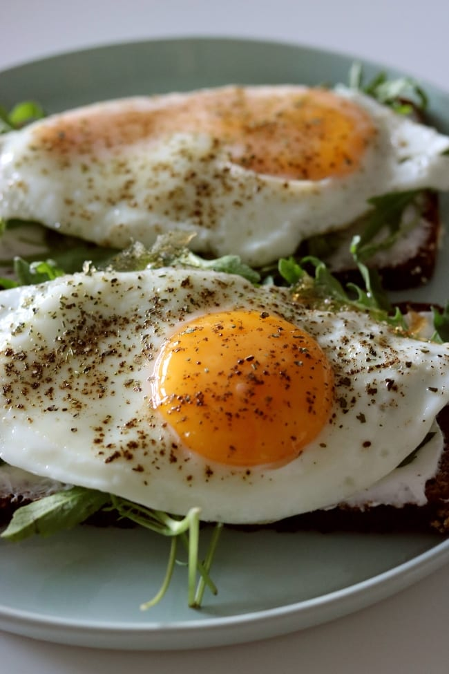 Fried eggs on green and toast