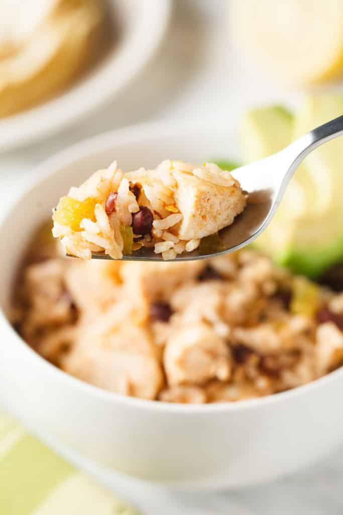 Mexican chicken and rice casserole on a fork.