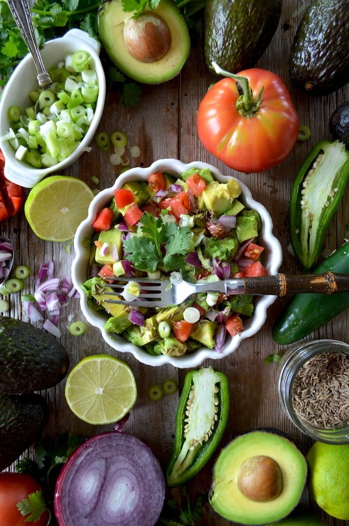 healthy salad with peppers, tomatoes, and avocados