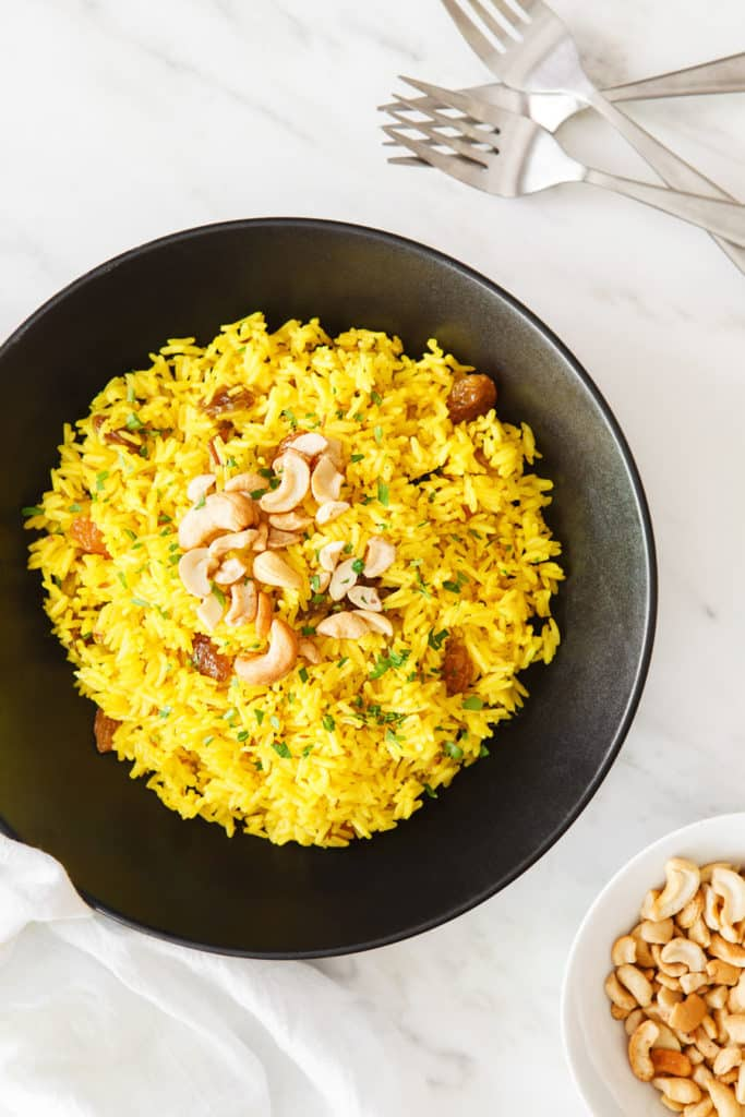 An Indian Rice Dish with golden raisins and cashews.