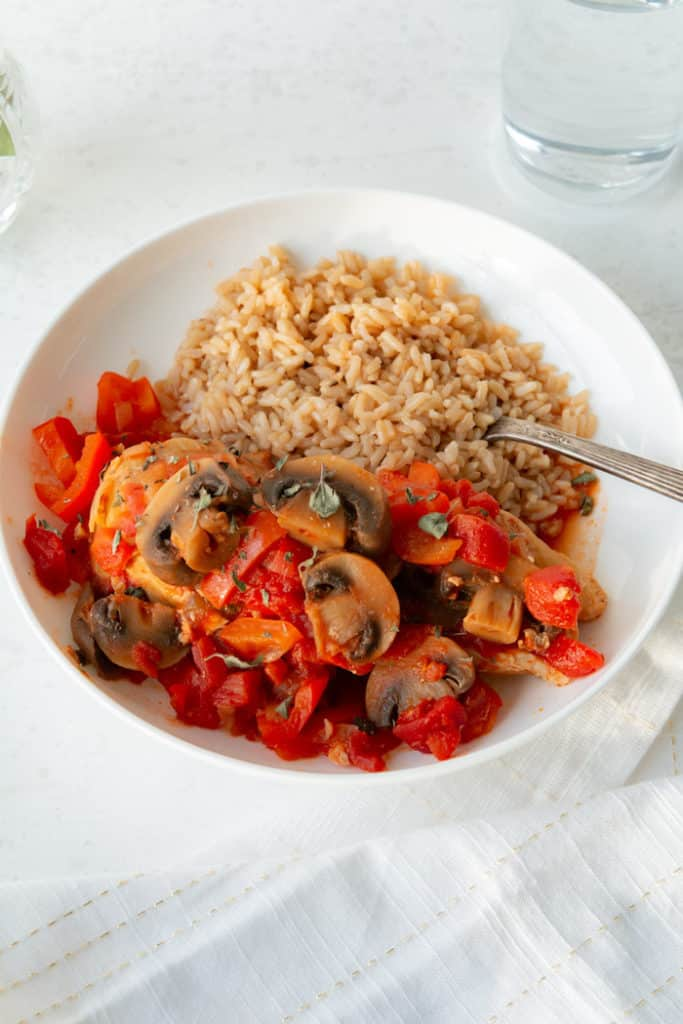 Classic Chicken Cacciatore cooked in the Instant Pot and served with rice.