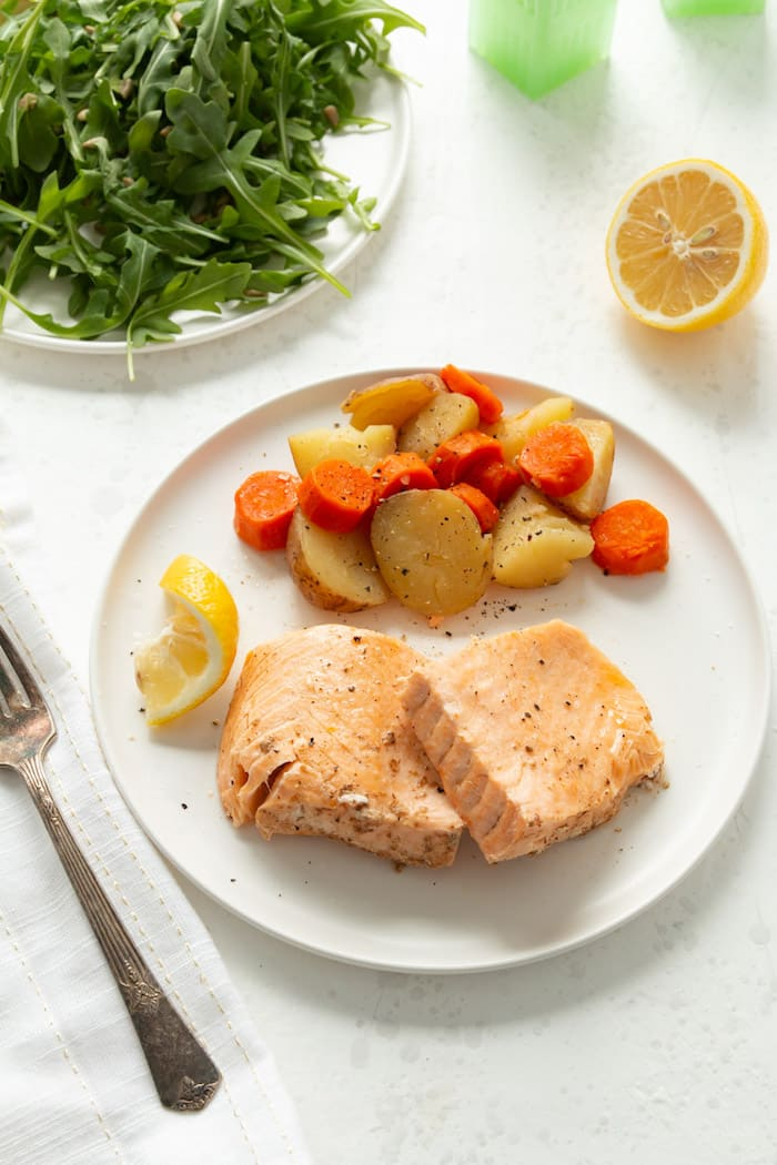 Delicious salmon filets and vegetables for a quick weeknight dinner cooked in the Instant Pot.