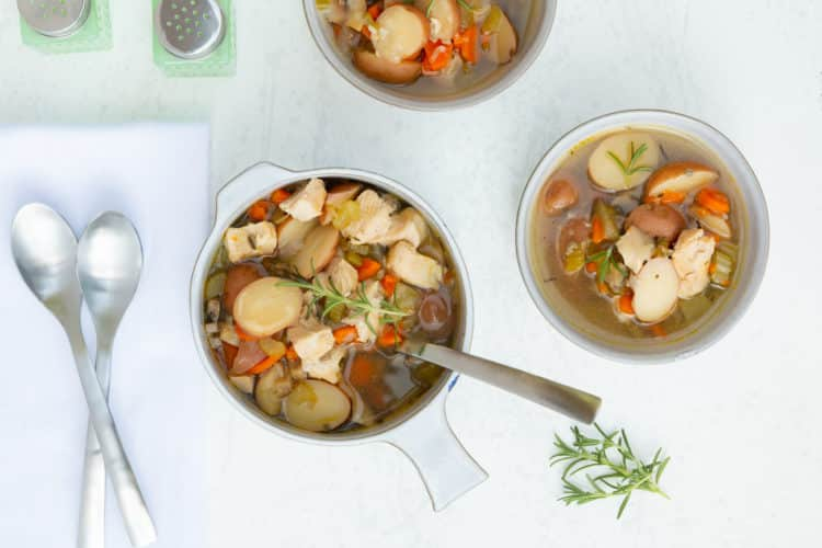 chicken stew in bowls with spoons