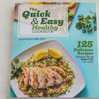 quick and easy cookbook cover on a white table