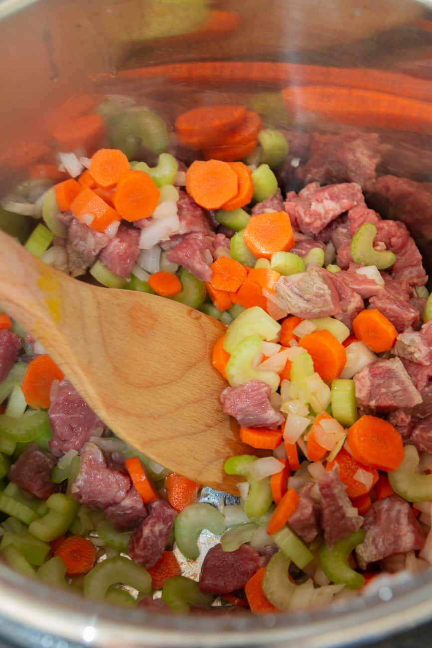 Saute beef and veggies in the Instant Pot for a delicious gluten-free soup.