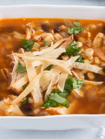 Instant Pot Chicken Tortilla Soup in a square white bowl