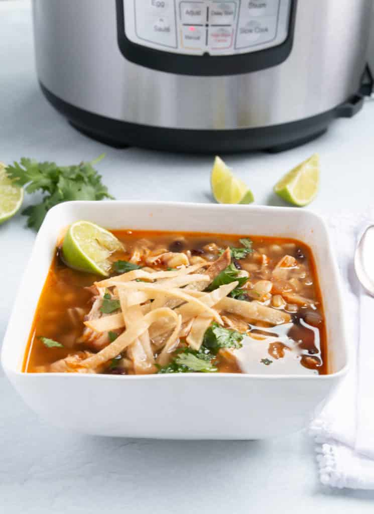 A bowl of hearty and gluten-free chicken tortilla soup.
