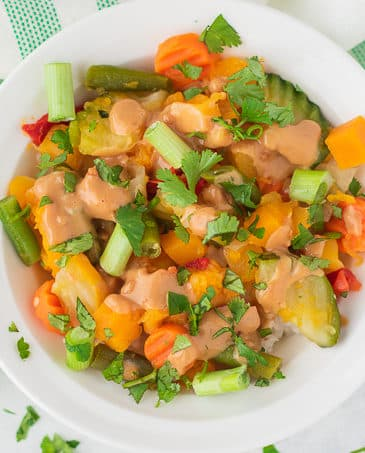 frozen vegetables peanut butter sauce in a white bowl