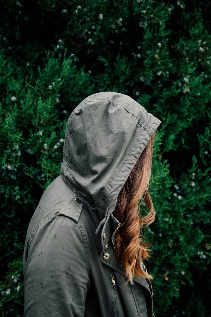 sad woman with a hood over her head