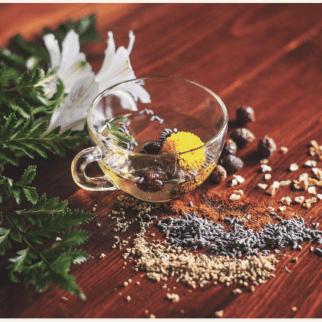 Herbal tea ingredients in a clear serving mug