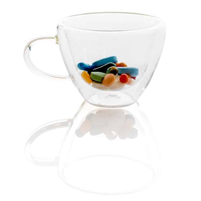 clear glass with pills