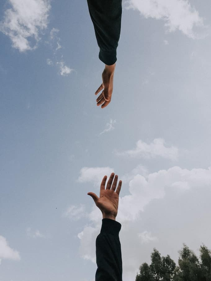 hands reaching for help