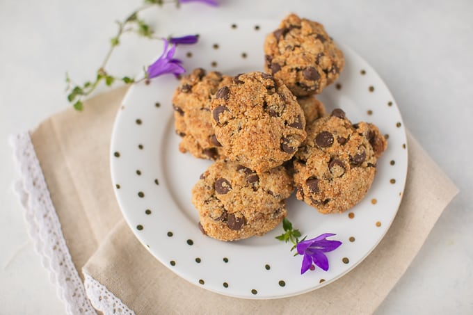 almond flour cookies on a plate with purple flowers