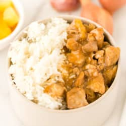 bowl of instant pot teriyaki chicken served with a gold fork