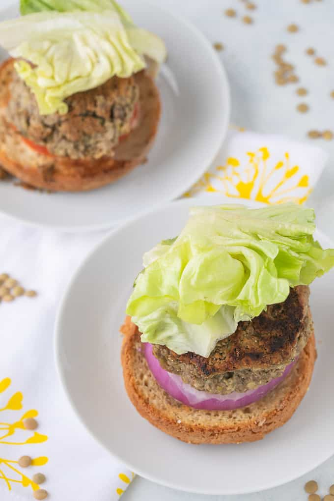 two lentil burgers on plates