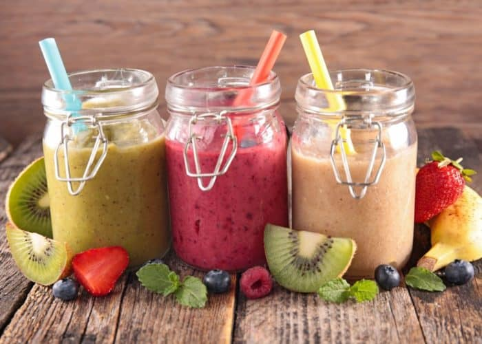 three smoothies ready to drink out of jars