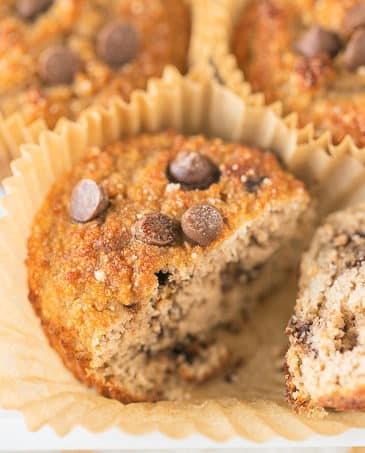 muffins on a white plate with one cut in half
