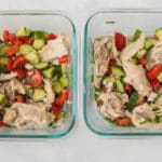 two meal prep containers with salad and chicken