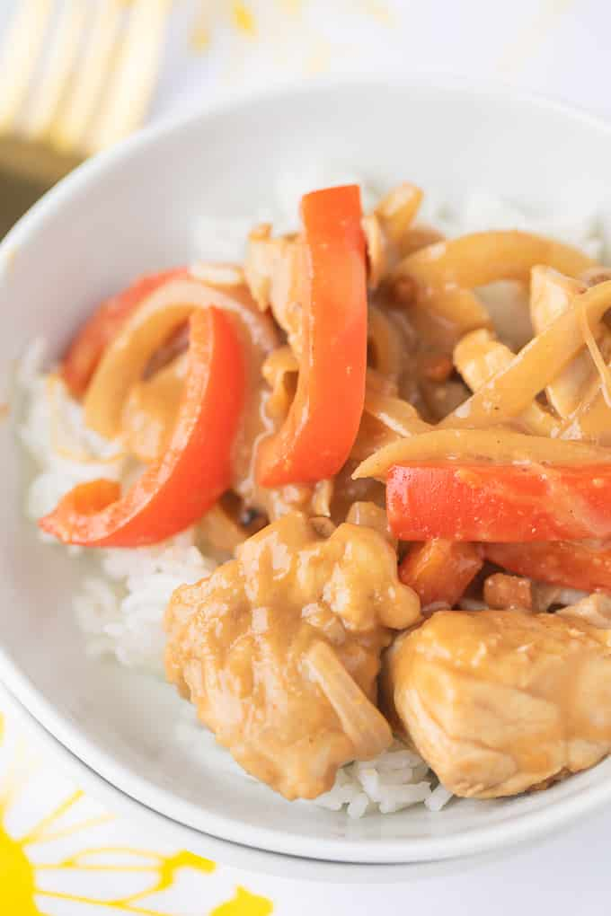 peanut butter chicken recipe with sliced red bell peppers