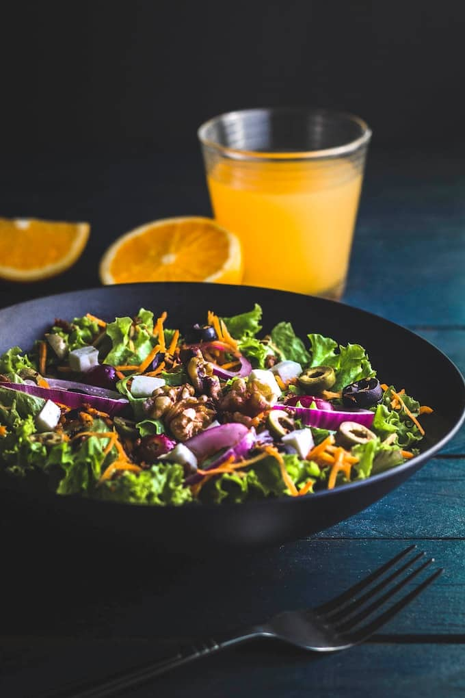 salad with a glass of orange juice