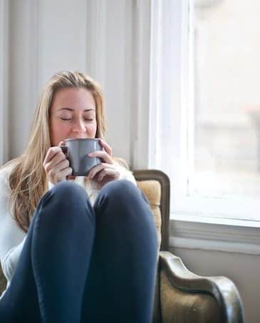 woman at home with coffee mug