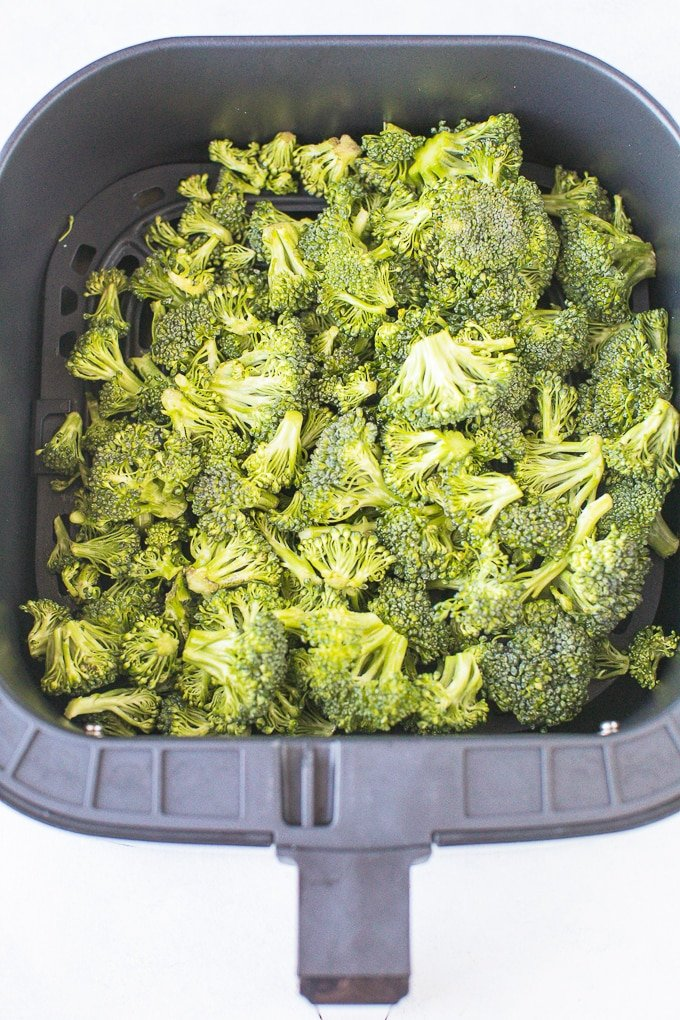 broccoli in air fryer basket ready to cook
