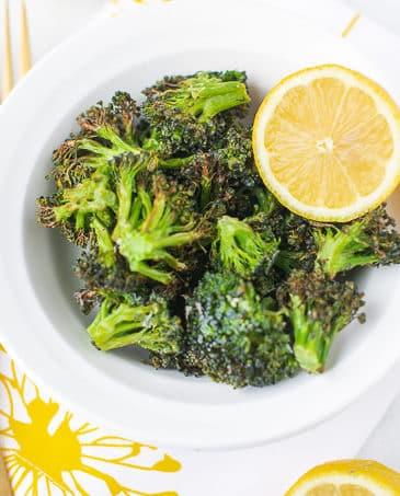 bowl of broccoli with a half of a lemon