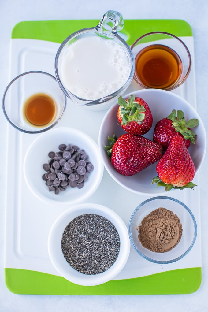 ingredients for chia pudding on a white cutting board